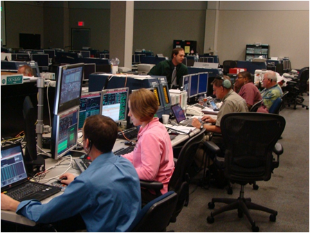 Members of the HYTHIRM team working in mission control