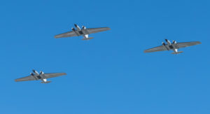 NASA's WB-57 aircraft flying in formation over Houston and JSC.