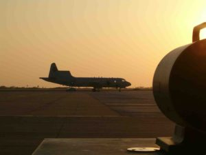 Navy P-3 sillouhetted against the sunset
