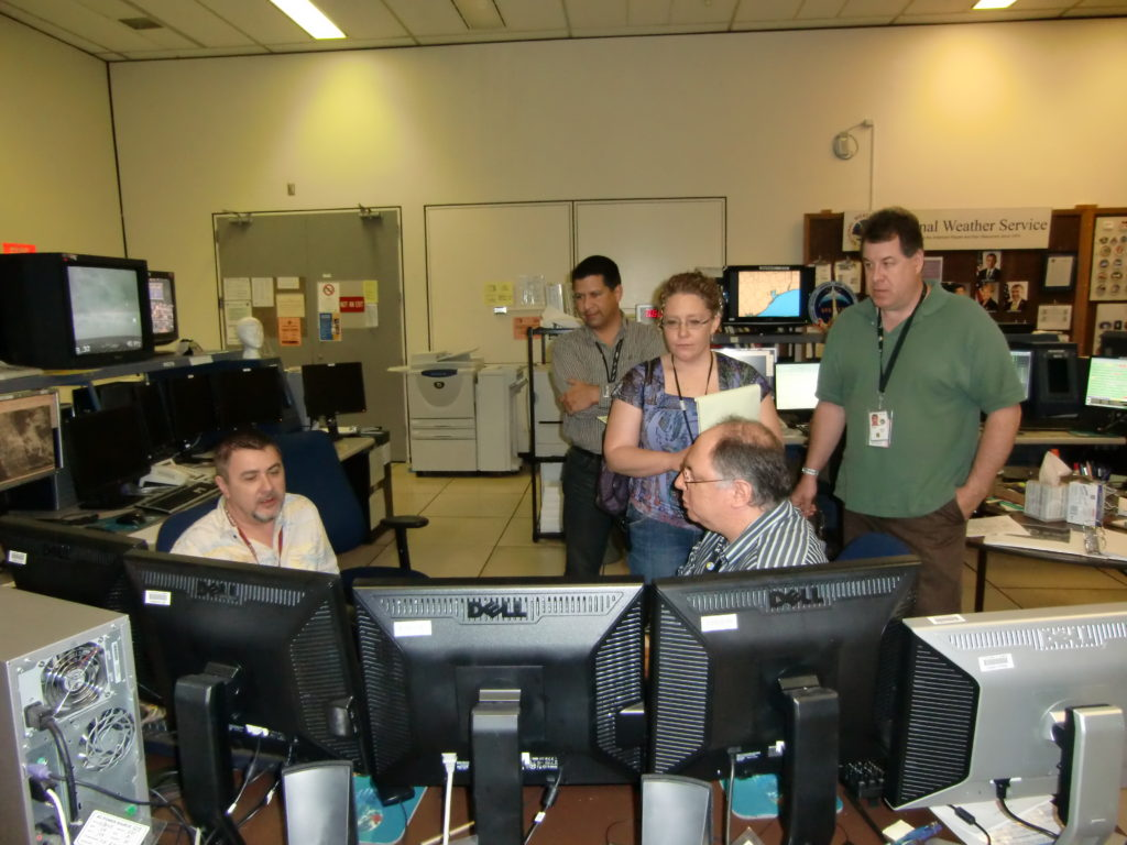 The team geting briefed on conditions by the meteorology office