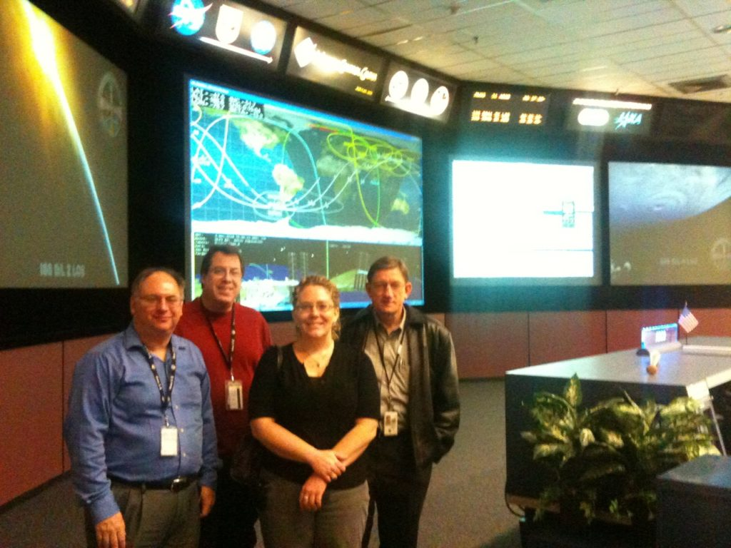 The team poses for a photo in mission control
