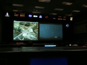 The main display of mission control during the mission