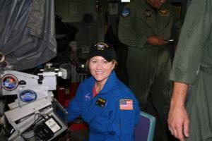 Debbie Tomek operating telescope on the P-3