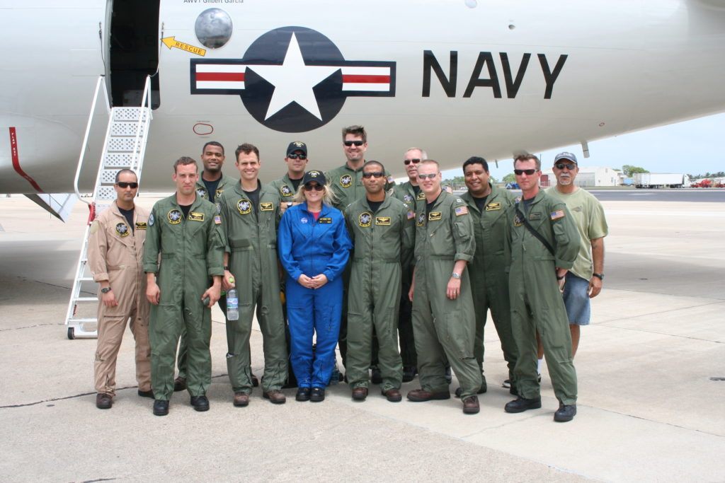 Crew of the Cast Glance Navy P-3 standing in front of the aircraft