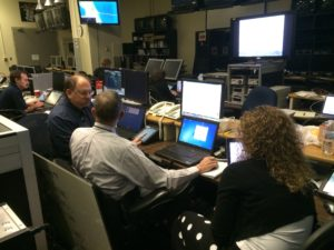 The team deep in discussion in mission control